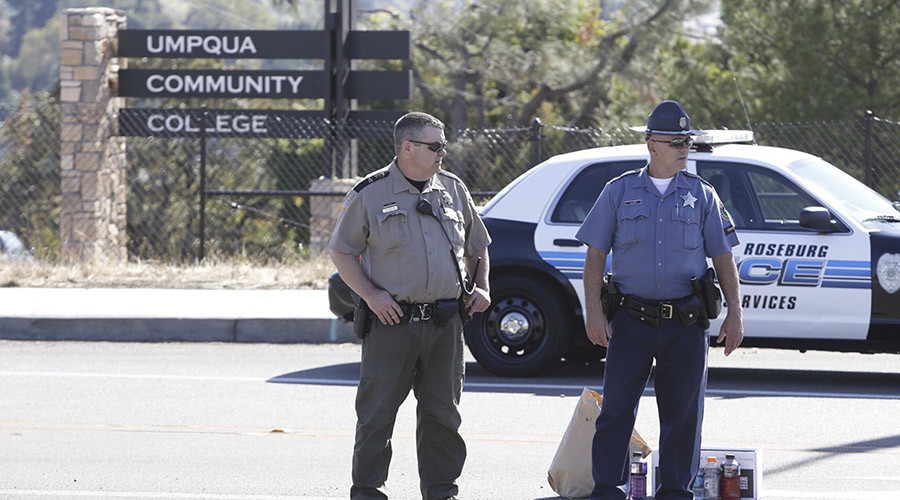 Police officers stand guard near the site of a mass shooting at Umpqua Community College in Roseburg Oregon